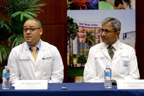 Humberto Liraino, left, makes comments during a news conference as Rajan Wadhawan listens at Florida Hospital